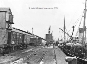 Coal wagons on the dockside